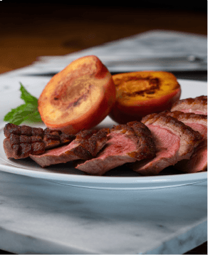 Seared duck breast with roasted peaches